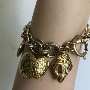 CHANEL Jewelry - CHANEL 7 Charms Gold Plated Bracelet Timeless